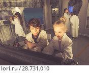 Купить «Children playing in bunker quest room», фото № 28731010, снято 21 октября 2017 г. (c) Яков Филимонов / Фотобанк Лори