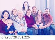 Купить «Laughing family making numerous photos», фото № 28731226, снято 27 мая 2019 г. (c) Яков Филимонов / Фотобанк Лори