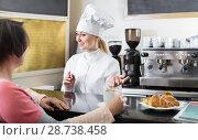 Купить «Female cook serving a dessert to the customer in the cafe», фото № 28738458, снято 22 июля 2018 г. (c) Яков Филимонов / Фотобанк Лори