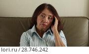Купить «Worried adult woman rubbing temple», видеоролик № 28746242, снято 1 июня 2018 г. (c) Ekaterina Demidova / Фотобанк Лори