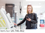 Купить «Casual caucasian woman using smart phone application and check-in machine at the airport getting the boarding pass.», фото № 28746462, снято 21 августа 2019 г. (c) Matej Kastelic / Фотобанк Лори