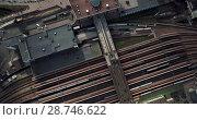 Купить «Aerial recording of railroad station», видеоролик № 28746622, снято 5 июля 2018 г. (c) Andriy Bezuglov / Фотобанк Лори