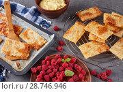 Купить «baked portions of puff pastry, close-up», фото № 28746946, снято 4 июля 2018 г. (c) Oksana Zh / Фотобанк Лори