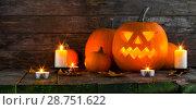 Купить «Halloween pumpkin and candles», фото № 28751622, снято 8 октября 2017 г. (c) Иван Михайлов / Фотобанк Лори
