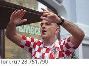 Купить «Болельщик из Хорватии», фото № 28751790, снято 15 июля 2018 г. (c) Виктор Юрасов / Фотобанк Лори