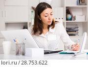 Купить «Unhappy girl manager working with laptop and documents at table», фото № 28753622, снято 1 мая 2018 г. (c) Яков Филимонов / Фотобанк Лори