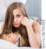 Купить «Offended girl lying on sofa with pillow», фото № 28753654, снято 24 июня 2017 г. (c) Яков Филимонов / Фотобанк Лори