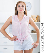 Купить «Young woman in white shorts at room», фото № 28753674, снято 24 июня 2017 г. (c) Яков Филимонов / Фотобанк Лори