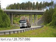 Купить «Sisu semi trailer of Telamurska Oy transports Metso Lokotrack crusher on scenic road. The machinery weighs 100000 kg. Salo, Finland - June 30, 2018.», фото № 28757086, снято 30 июня 2018 г. (c) age Fotostock / Фотобанк Лори