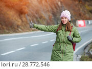 Купить «Woman tourist hitch-hiking on the road», фото № 28772546, снято 20 ноября 2017 г. (c) Pavel Biryukov / Фотобанк Лори