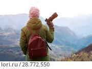 Купить «Woman takes pictures of landscape», фото № 28772550, снято 20 ноября 2017 г. (c) Pavel Biryukov / Фотобанк Лори