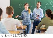 Купить «Girl answering near blackboard», фото № 28772854, снято 25 мая 2018 г. (c) Яков Филимонов / Фотобанк Лори