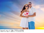 Купить «happy couple with bunch of flowers hugging», фото № 28773070, снято 23 июля 2014 г. (c) Syda Productions / Фотобанк Лори