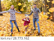 Купить «happy family playing with autumn leaves at park», фото № 28773162, снято 19 октября 2017 г. (c) Syda Productions / Фотобанк Лори