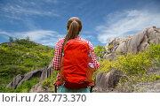 Купить «woman with backpack over seychelles island», фото № 28773370, снято 25 июля 2015 г. (c) Syda Productions / Фотобанк Лори