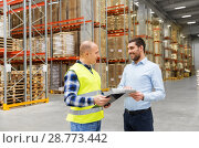 Купить «worker and businessman with tablet pc at warehouse», фото № 28773442, снято 9 декабря 2015 г. (c) Syda Productions / Фотобанк Лори