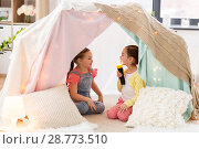 Купить «little girls with torch light in kids tent at home», фото № 28773510, снято 18 февраля 2018 г. (c) Syda Productions / Фотобанк Лори