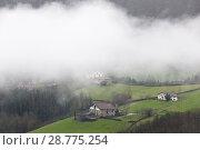 Купить «Fog over the lonely hamlets of Abaltzisketa, Guipúzcoa, Spain», фото № 28775254, снято 21 октября 2018 г. (c) age Fotostock / Фотобанк Лори