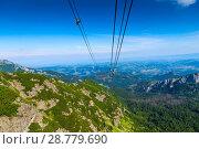 Купить «Ropes for the cable car in the beautiful glacier of Tatra, Poland», фото № 28779690, снято 19 августа 2017 г. (c) Константин Лабунский / Фотобанк Лори