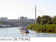 Купить «The small motor ship floats with passengers down the river Tura along the embankment in Tyumen, Russia», фото № 28779842, снято 16 июля 2018 г. (c) Землянникова Вероника / Фотобанк Лори