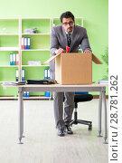 Купить «Male employee collecting his stuff after redundancy», фото № 28781262, снято 14 мая 2018 г. (c) Elnur / Фотобанк Лори