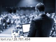 Купить «Public speaker giving talk at business event.», фото № 28781494, снято 19 июля 2018 г. (c) Matej Kastelic / Фотобанк Лори