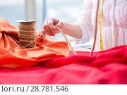 Купить «Woman tailor working on new dress designs», фото № 28781546, снято 13 апреля 2018 г. (c) Elnur / Фотобанк Лори