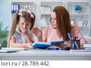 Купить «Mother helping her daughter to do homework», фото № 28789442, снято 21 июня 2017 г. (c) Elnur / Фотобанк Лори
