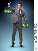 Купить «Businessman trying to find balance between home and work», фото № 28789482, снято 18 января 2019 г. (c) Elnur / Фотобанк Лори