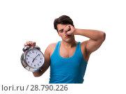 Купить «Man waking up with alarm clock isolated on white», фото № 28790226, снято 7 ноября 2016 г. (c) Elnur / Фотобанк Лори