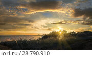 Купить «Закат над Волгой летним вечером», фото № 28790910, снято 8 июля 2018 г. (c) oleg savichev / Фотобанк Лори
