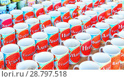 Russia, salt-Iletsk, August 2017: glasses with a name standing in a row in the market. Text in Russian: Varya Semyon Aydar Eugenia Darina Lydia Timothy Ira Zhanna Stanislav and other names. Редакционное фото, фотограф Акиньшин Владимир / Фотобанк Лори