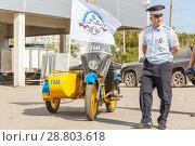 "Купить «Soviet policeman in uniform on a Soviet police motorcycle ""Ural"" on a sunny day.», фото № 28803618, снято 16 сентября 2017 г. (c) Акиньшин Владимир / Фотобанк Лори"