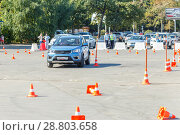 Russia, Samara, September 2017: the driver on the new car passes the driving test for driving the car. Редакционное фото, фотограф Акиньшин Владимир / Фотобанк Лори
