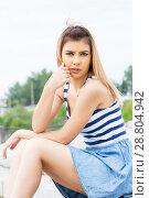 Купить «Портрет девушки в полосатой майке», фото № 28804942, снято 6 июня 2018 г. (c) Момотюк Сергей / Фотобанк Лори