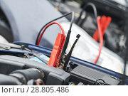Купить «Automobile help. booster jumper cables charging automobile discharged battery», фото № 28805486, снято 1 апреля 2018 г. (c) Дмитрий Калиновский / Фотобанк Лори