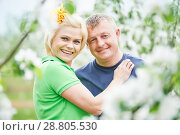 Купить «Family. Smiling adult couple in love. Blossoming tree garden», фото № 28805530, снято 12 мая 2016 г. (c) Дмитрий Калиновский / Фотобанк Лори