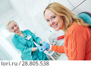 Купить «Blood test with disposable lancelet. nurse and woman at clinic», фото № 28805538, снято 30 января 2014 г. (c) Дмитрий Калиновский / Фотобанк Лори