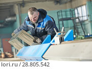 Купить «Sheet metal folding. industrial worker works with detail at bending machine», фото № 28805542, снято 28 января 2014 г. (c) Дмитрий Калиновский / Фотобанк Лори