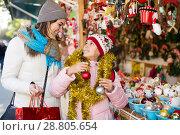 Купить «Smiling mother with small daughter in market», фото № 28805654, снято 21 сентября 2018 г. (c) Яков Филимонов / Фотобанк Лори