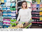 Купить «Woman doing shopping with shopping cart», фото № 28805806, снято 23 ноября 2016 г. (c) Яков Филимонов / Фотобанк Лори