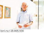 Купить «Man visiting painting exhibition», фото № 28805930, снято 9 июня 2018 г. (c) Яков Филимонов / Фотобанк Лори