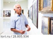 Купить «Man visiting painting exhibition», фото № 28805934, снято 9 июня 2018 г. (c) Яков Филимонов / Фотобанк Лори
