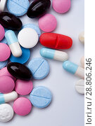Купить «Colorful medical pills and capsules, top view», фото № 28806246, снято 7 августа 2017 г. (c) Pavel Biryukov / Фотобанк Лори