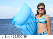 girl of thirteen with an inflatable mattress. Стоковое фото, фотограф Типляшина Евгения / Фотобанк Лори