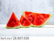 Купить «Pieces of watermelon on a wooden table», фото № 28807030, снято 15 июля 2018 г. (c) Елена Блохина / Фотобанк Лори