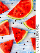 Купить «Pieces of watermelon on a wooden table», фото № 28807042, снято 16 июля 2018 г. (c) Елена Блохина / Фотобанк Лори