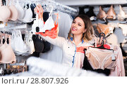 Купить «Customer woman in underwear shop», фото № 28807926, снято 20 марта 2017 г. (c) Яков Филимонов / Фотобанк Лори