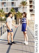 Купить «Man and girl standing and hugging», фото № 28808110, снято 27 июня 2018 г. (c) Яков Филимонов / Фотобанк Лори