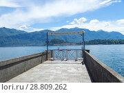 Купить «Tremezzo, Italy - July 6 2018: pier on Lake Como. The third largest lake in Italy (length 47 km, width - up to 4 km), one of the deepest in Europe (up to 410 m)», фото № 28809262, снято 6 июля 2018 г. (c) Григорий Стоякин / Фотобанк Лори